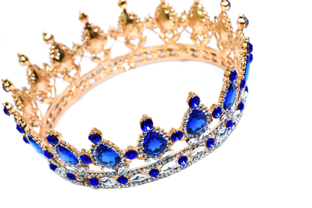Gold crown with blue and white jewel of precious stones. Stock Photo