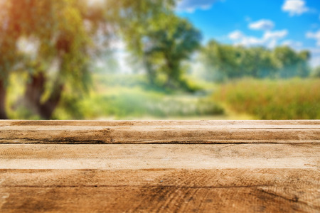 Sunny day with beautiful landscape and wood terrace. Wood table nature. Stock Photo
