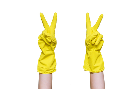 Woman hands symbolizes the victory of her fingers. Hands in yellow gloves. Getting started cleaning.