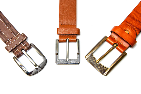 Leather belt on white background. Metal buckle on leather belt.