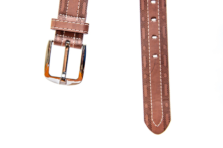 Belt leather with the metal chromeplated fastener on a white background. Clothes detail accessory copy space. Stock Photo