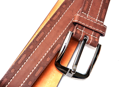 Leather belt on white background. Metalichesky buckle on leather belt.