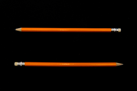 Two pencils on dark surface. Top view with copy space. Stock Photo