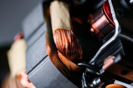 Technological macro, metallic copper winding of the electric motor. 스톡 콘텐츠
