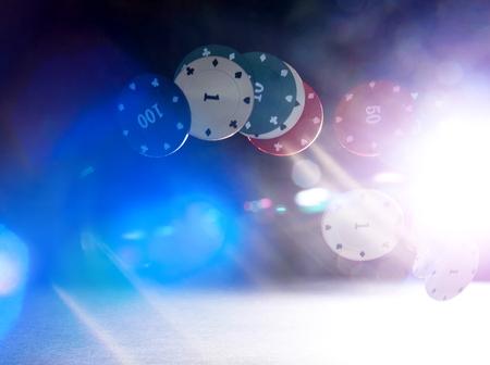Falling casino chips with light back flare flash and glare Reklamní fotografie