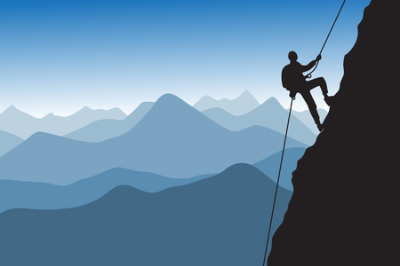 Silhouette of the climber who is climbing up the mountain against the ridge