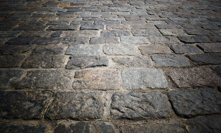 Old cobblestone street road, vintage style with picture vignetting. Stone road, pavement Stockfoto