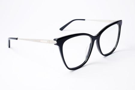 Beautiful female reading black glasses on white background. Фото со стока