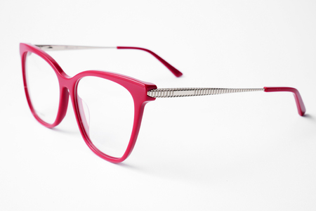 Beautiful female reading red glasses on white background.