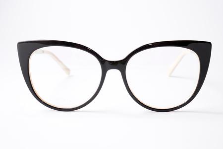 Fashionable and stylish female plastic frame. Beautiful female reading glasses Фото со стока