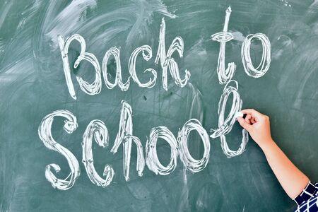 Teacher written on blackboard back to school 版權商用圖片
