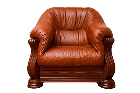Comfortable leather brown armchair isolated on white background.