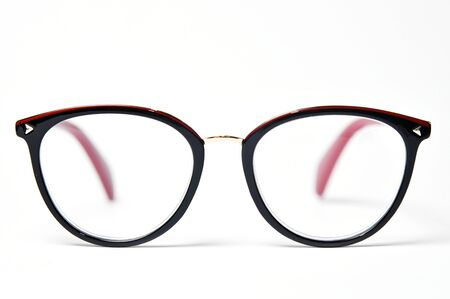 Plastic glasses frame rim on white background close up