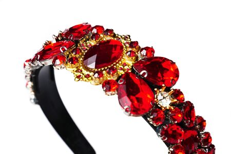 Jewelry queen crown with red gemstones isolated on white