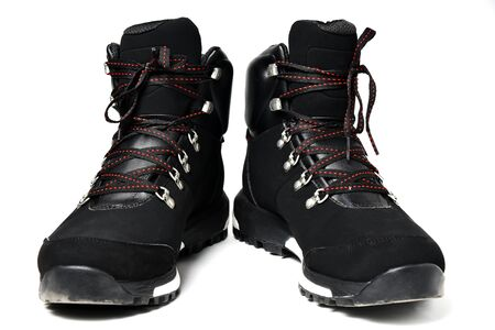 Winter man foot boots isolated on white background. Sport black footwear. 写真素材