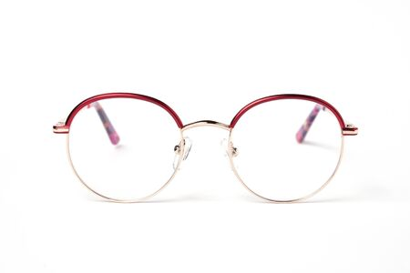 Round metallic gold glasses for a girl on a white background.