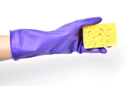 House cleaning, yellow washcloth in hand in glove for cleaning. Protecting the body from chemistry. Washing dishes.