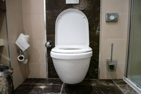 Room is a toilet with a white toilet. Toilet with marble floor.