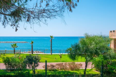 Picturesque seascape view on Mediterranean Sea. Coast of Sea. Closed private property of the sea coast. Fence passage to a beautiful beach.