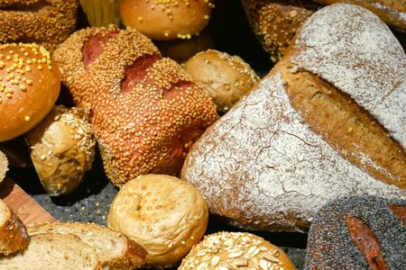 An assortment of delicious, fresh bread on the counter.