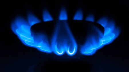 Burning blue gas on a black background. 写真素材