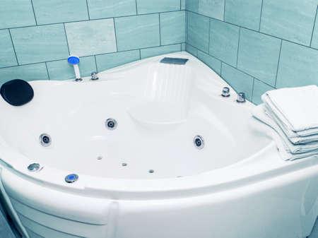 White spa bath with hydromassage. Aqua relaxation room