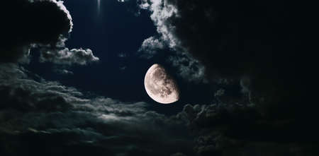 Night sky with a big moon and clouds. Fantasy view on mystic clouds night scape with moon.