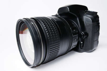Dslr camera on white background. Zoom lens close-up wide view. Foto de archivo