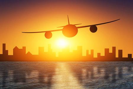 Plane flies on the background of a beautiful sunset, city and sea Фото со стока