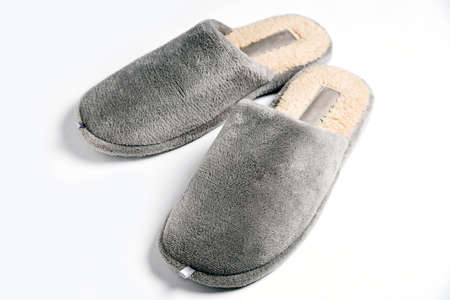 Home comfortable domestic male shoes slippers on white background Фото со стока