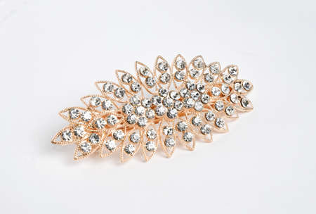Jewelry brooch - bijouterie luxury accessory on white background