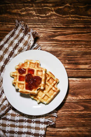Belgian waffles, dessert food with jam over head view Фото со стока