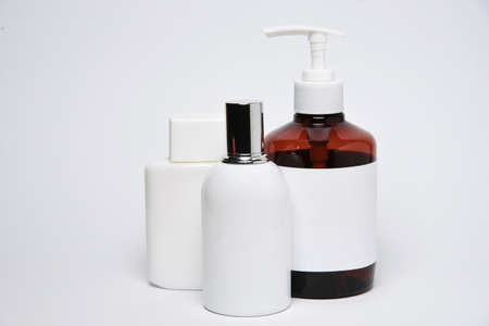 Bottles and jars with copy space on a white background. Mock up bottles. Фото со стока