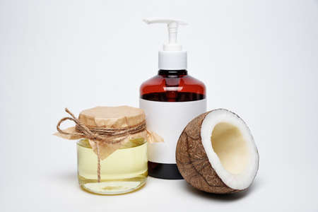 Organic natural cosmetic coconut oil with flask on white background. Фото со стока