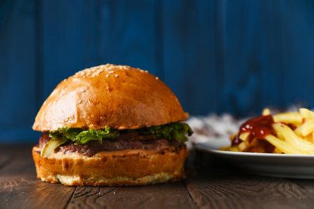 American fast food hamburger beef on wood table Фото со стока