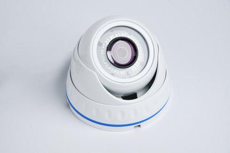 CCTV camera, property protection. White round camera surveillance on a white background.