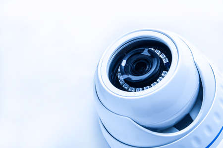 Security CCTV camera, tinted image in blue tones