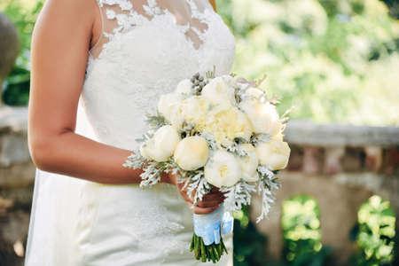 Bride hold in hand bouquet. Wedding ceremony.
