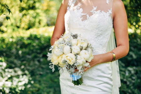 Wedding bouquet on bride hand. Married ceremony.