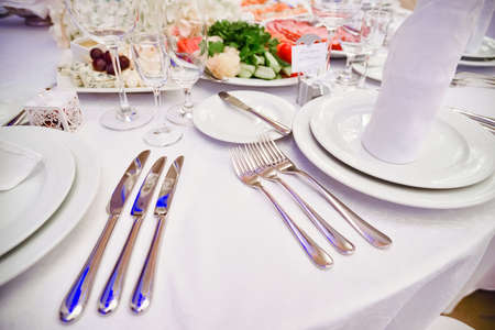 Knives and forks on the table, table laying