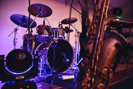 Concert scene with blue light, drum set