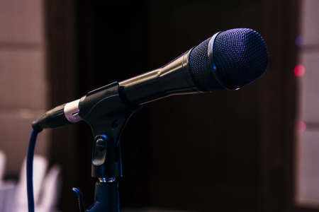 Black close up microphone in concert hall, audio system in studio