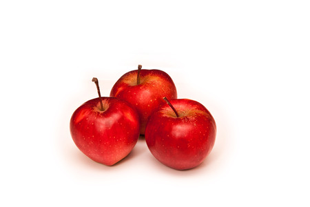 Three red apples on a white background isolated. photo