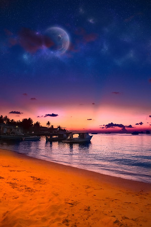 Paradise Maldives beach at pink sunset, glowing light in the restaurant over water, with cople and boats romantic place for honeymoon vacation, summer evening on exotic island, Maldives landscape