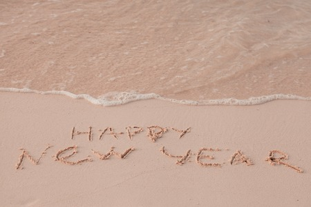 replace: New Year 2017 is coming concept. Inscription Happy New Year 2017 replace 2016 concept on the sea beach