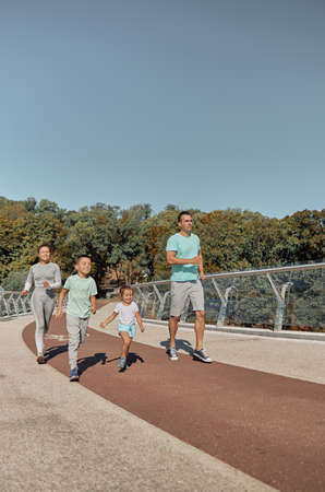 happy healthy and sporty family are doing workout trainings in sunny day Stock fotó - 154911275