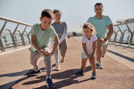 happy healthy and sporty family are doing workout trainings in sunny day Stock fotó - 154911298
