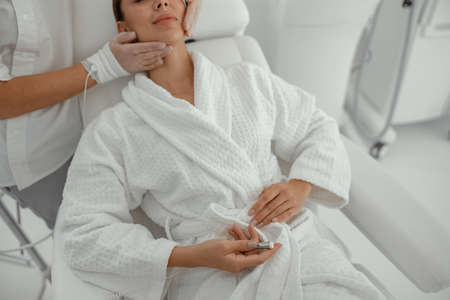 Beautiful healthy smiling caucasian woman is doing beauty procedures at spa and healthcare salon