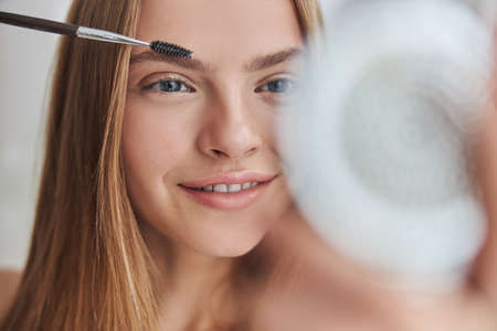 Young female with natural healthy fresh skin at home Stock fotó