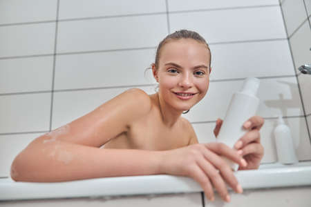 Young female with natural healthy fresh skin at home bathroom Stock fotó